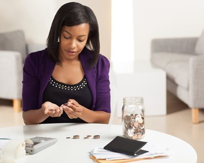 Woman counting her change